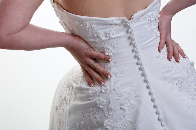 Bride Waiting for her limo and unable to do up her last button