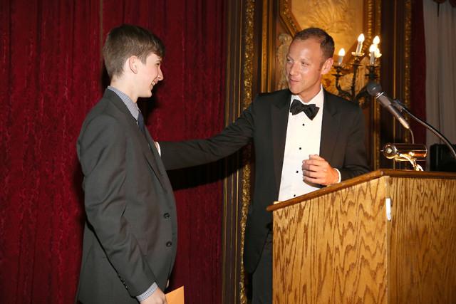 Ian Alteveer presents the Jeffrey Ahn, Jr. Fellowship award to Beckett Fine.