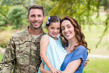 Handsome soldier reunited with family on
