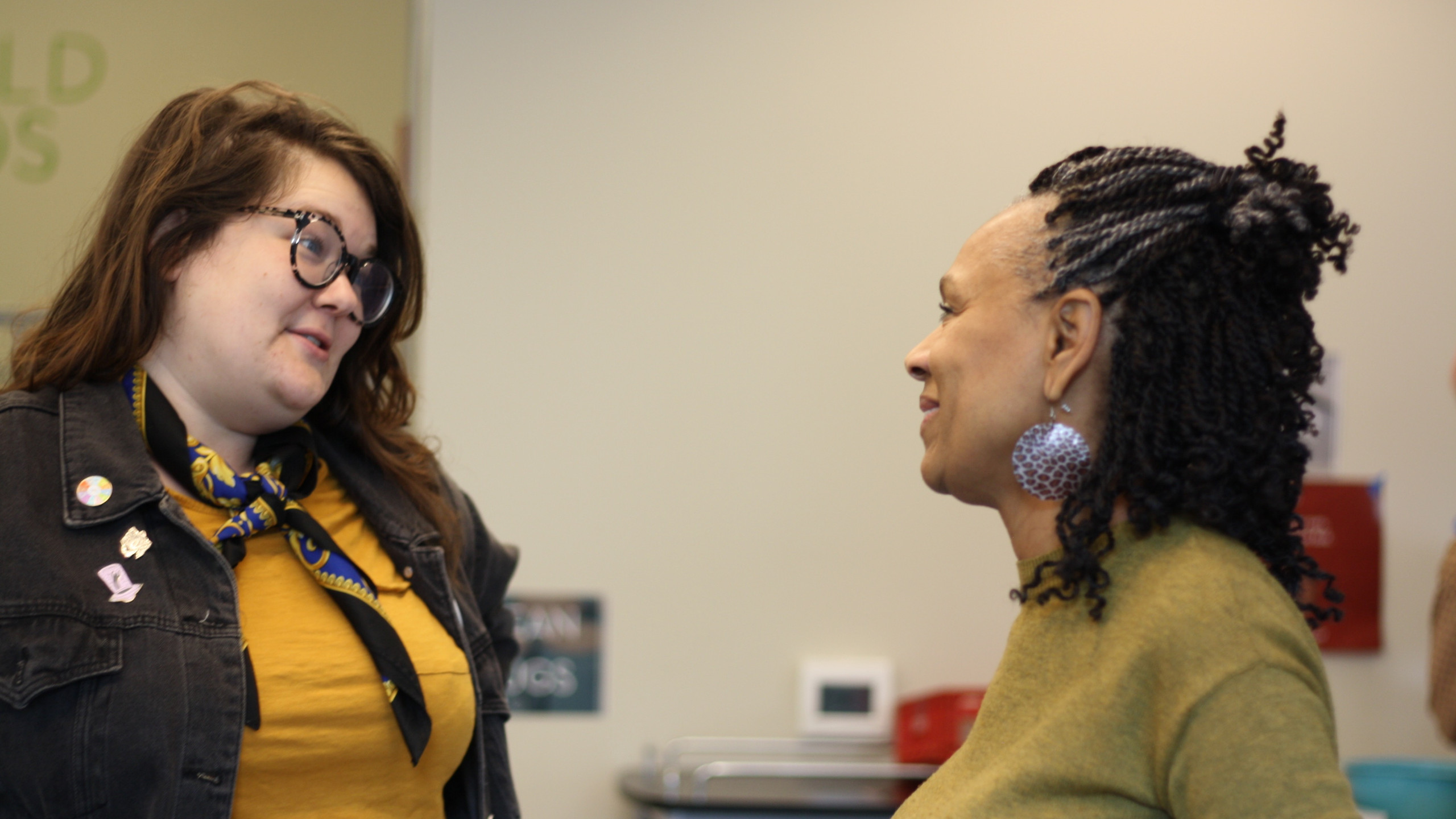 Photo of Spenser Norris and Derona King looking at one another talking.