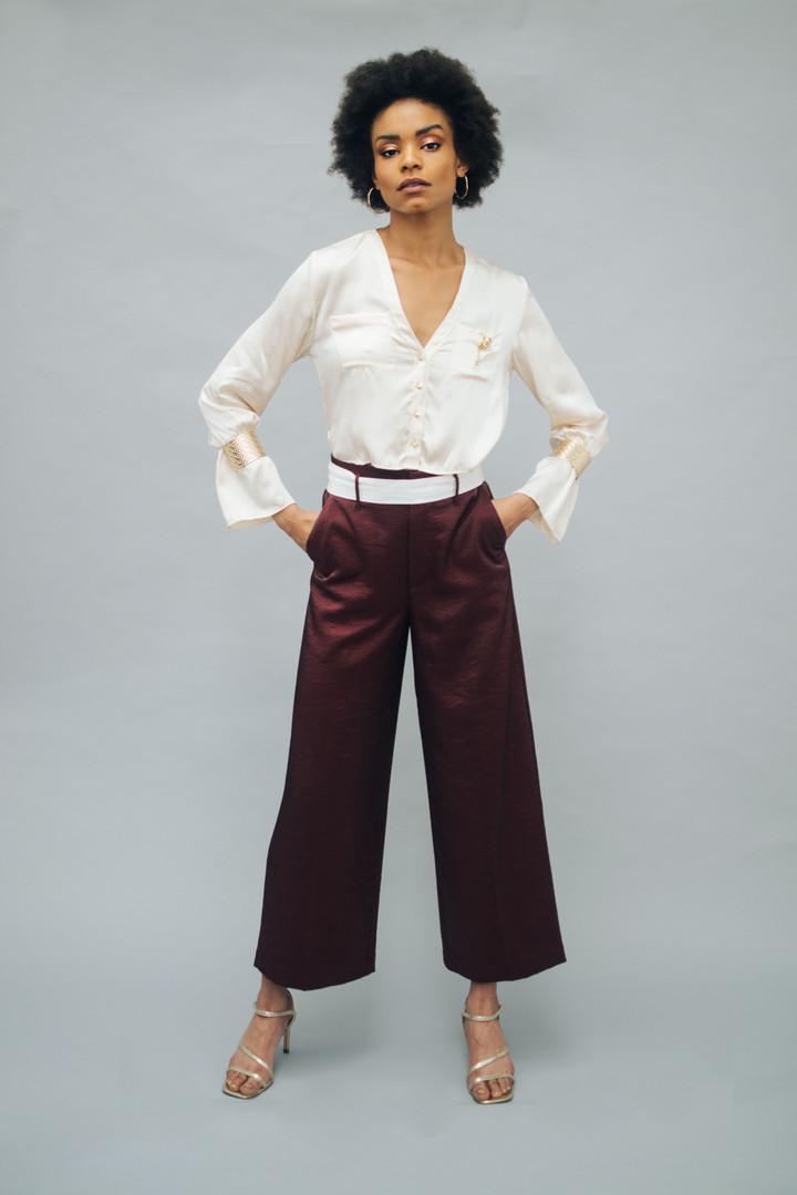 Top: Staud Pants: Skotch and Soda Earrings: Pandora Shoes: Alexander Birman