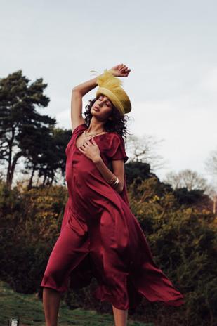 Dress: Magpies and Peackock Hat: Diana Cavagnaro  Accessories: Sophie Buhai