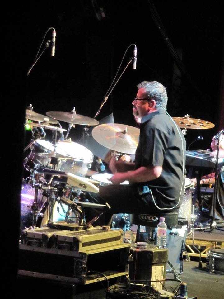 behind drums