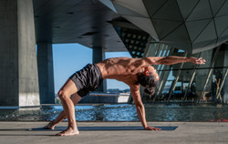 yoga teacher wild thing camatkarasana