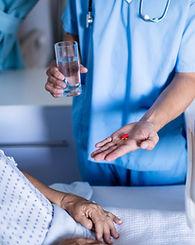 doctor-serving-medicine-to-female-senior