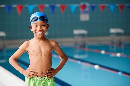 portrait-of-boy-standing-by-edge-of-swim