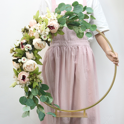 Golden Hoop Arch Centrepiece with floral arrangement