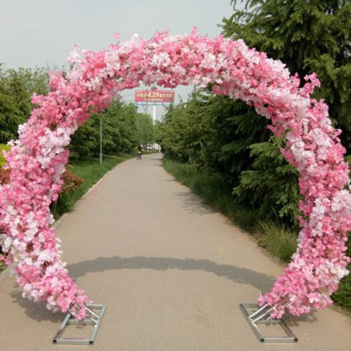 Pink cherry blossom and Metal arch wedding backdrop arch