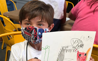 masked boy with art.jpg