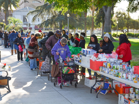 Riverside Alumni Chapter Assists with the 2019 Fair Housing Council Turkey Basket Giveaway