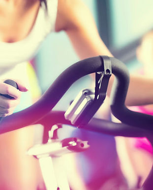 woman-spin-bike-class-gym-06092015.jpg