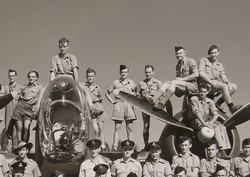 my father is the one on the port wing behind prop with dark cap and hand on hip