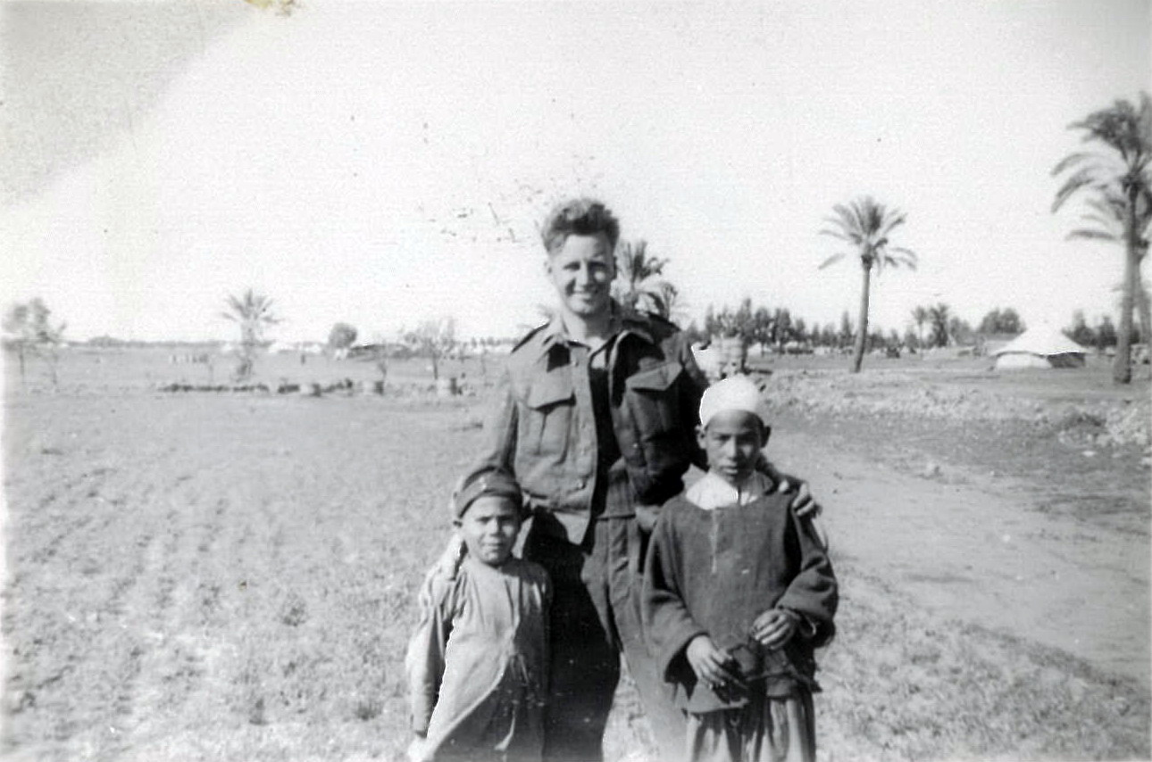 Hennry Flynn Benghazi April 1944 on the way to the dentist with two local children
