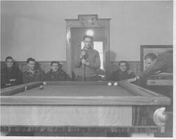 454 boys playing pool