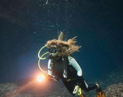 Scuba diver exploring underwater cave. H