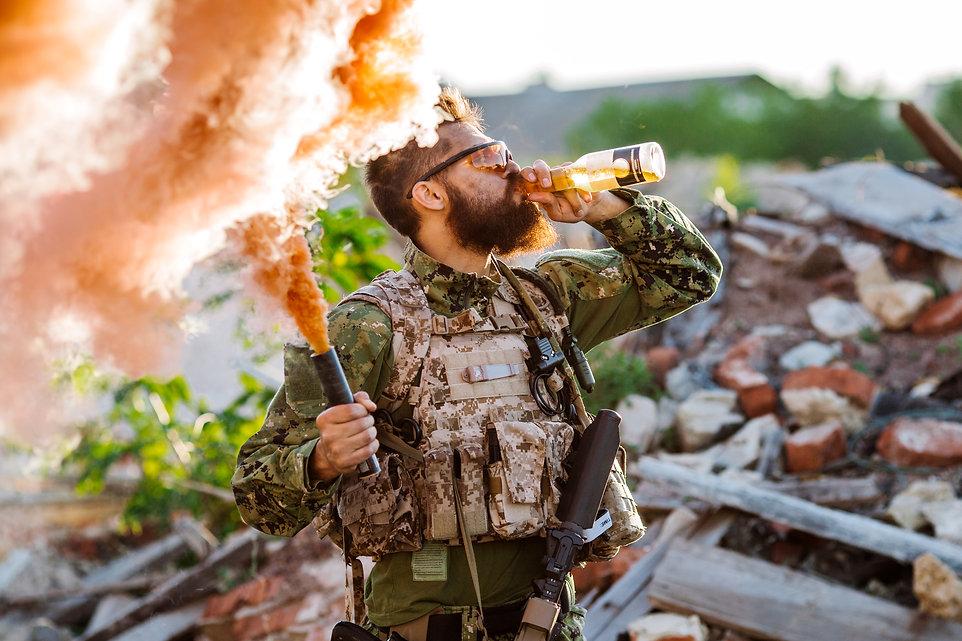 Happy Soldier Celebrating. Soldier drink