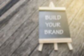 mini black board written build your bran