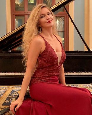 Svetlana Kimmel by piano seat .jpg