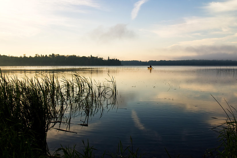 Canoeing on the early morning waters
