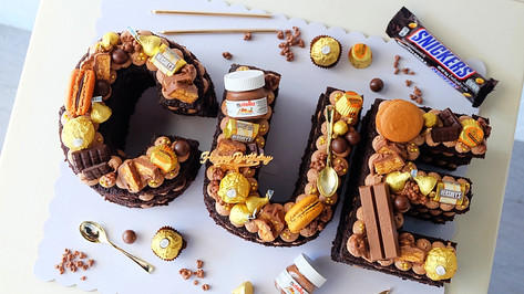 CUE Letter Cake