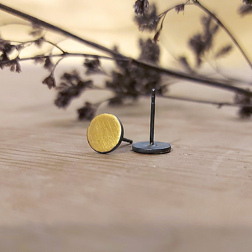 Oxidised round studs with brushed gold front