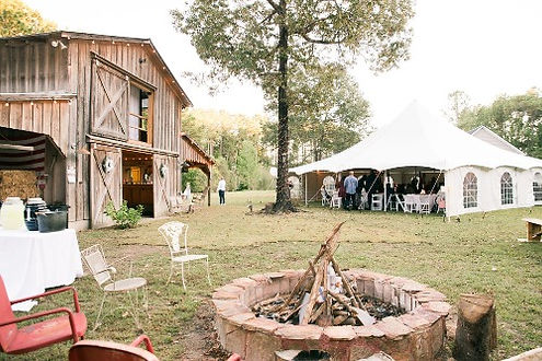 Event at the barn venue with large tent from country aire rental.jpg
