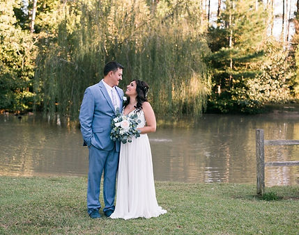 Bride and groom picture by the pond with the weeping willow in the back .jpg