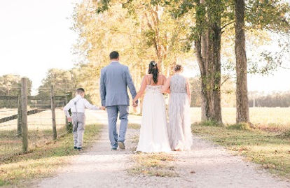 picture of family walking down the drive