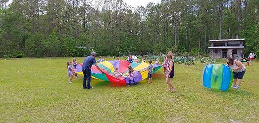 Birthday fun playing with huge parachute.jpg