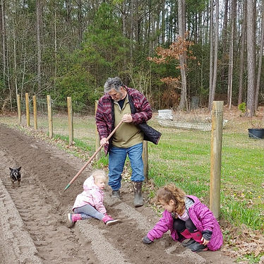 """Lila and Sophia helping Kevin Martin""""Papa"""" in the garden.jpg"""