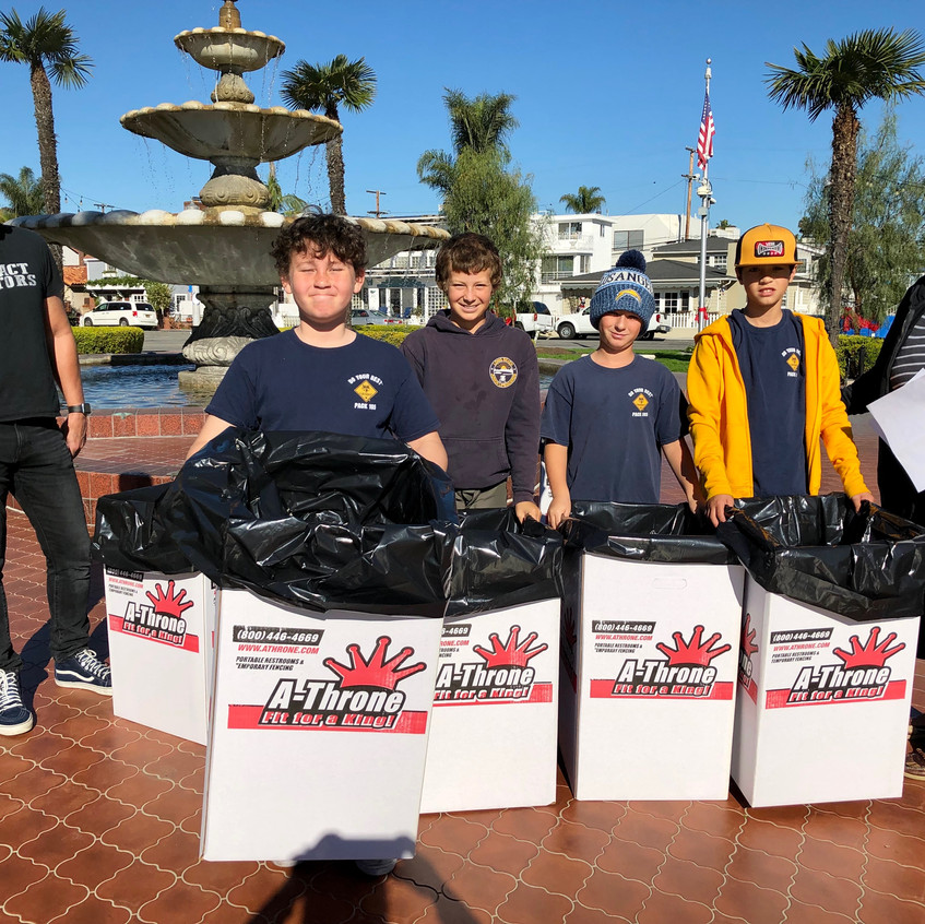 Cub Scouts put out trash containers
