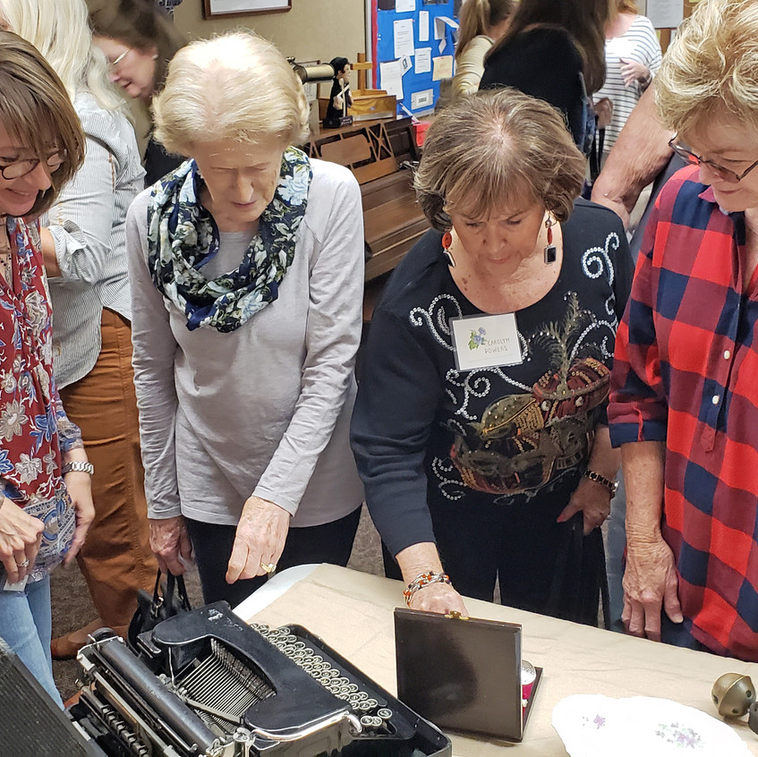 members checking our typewritter