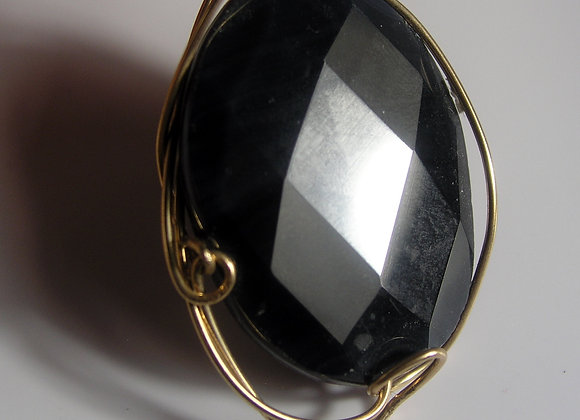 Faceted Black Onyx Oval in Goldfilled Wire