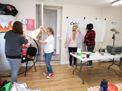 The women's group gets stuck into the banner and fire hoop