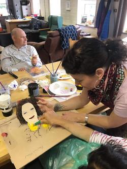 Kate assists pauline to paint her portrait