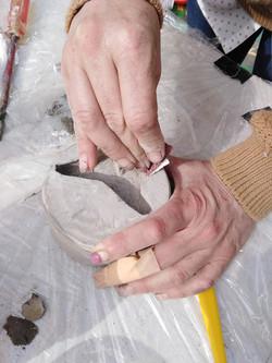Sanding the sculptures