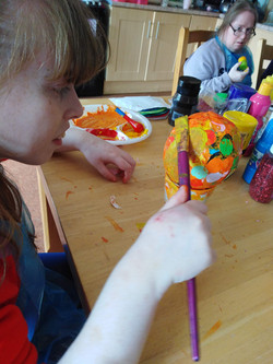 Painting paper mache forms