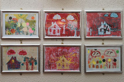 Mixed media pieces, framed at the centre.