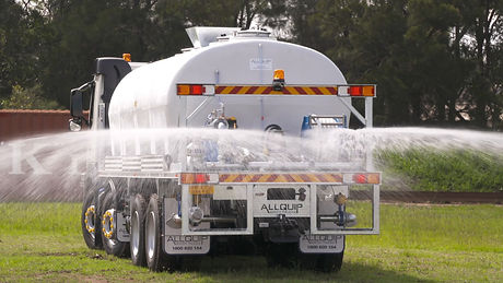 Allquip poly water truck action shot with rear sprays in operation