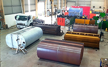 Fabrication warehouse with different steel and poly water tanks