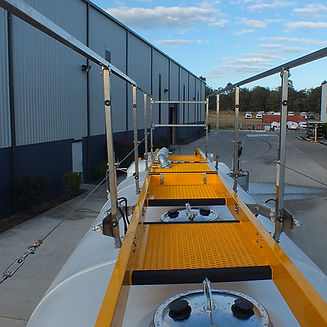 Safety platform to access poly tank on a bulk water tanker