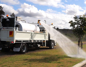 Slide-in water tank with water cannon mounted on a tipper truck