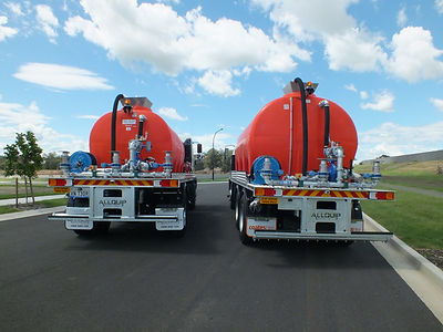 Two orange poly water tanks built by Allquip