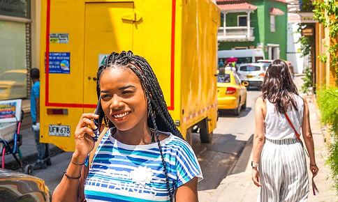 Smiling girl talking on phone