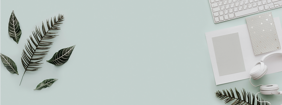 mint green desk with greenery.png