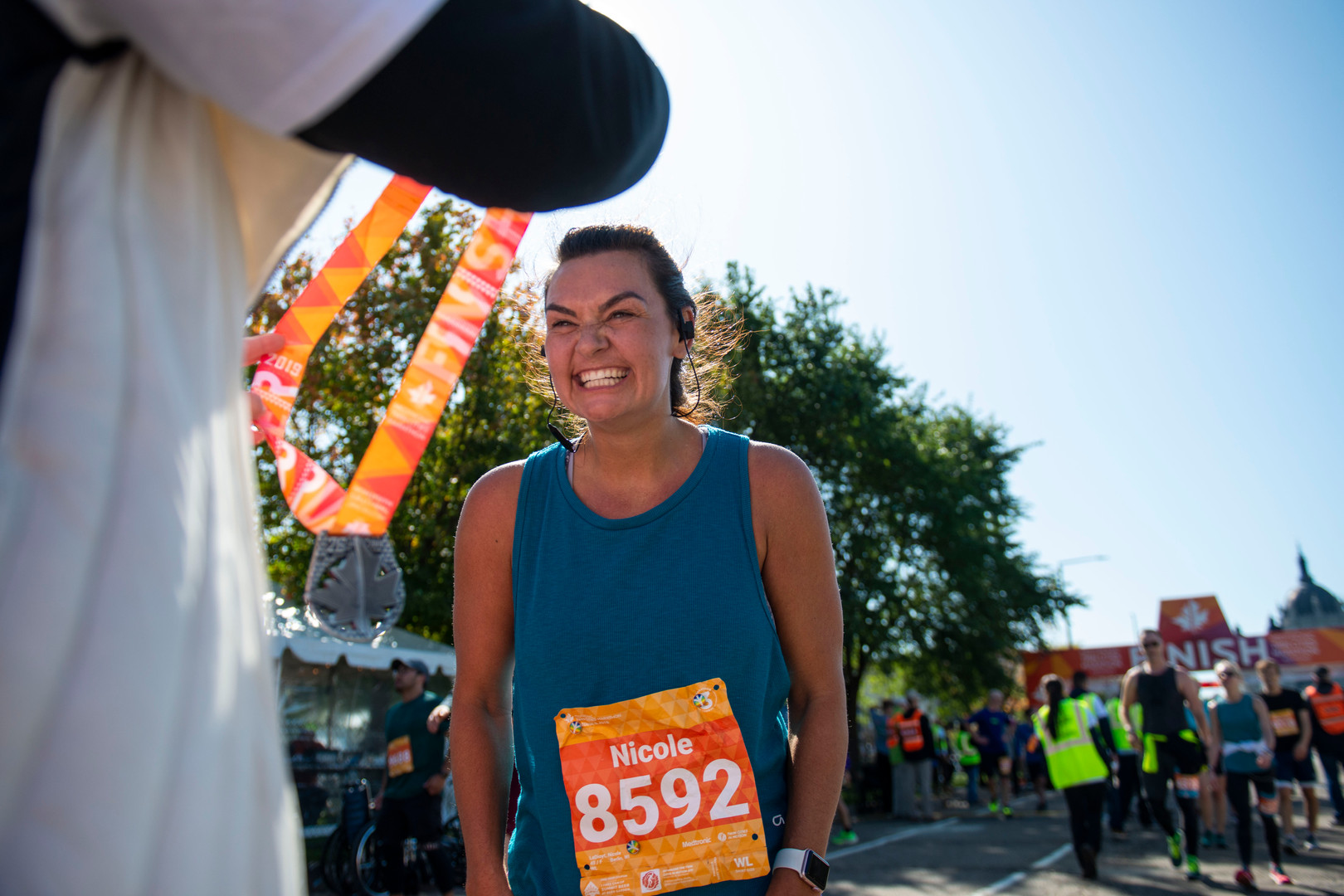 Nicole Ledioyt receives a medal after finishing the Twin Cities Marathon on Sunday, Oct. 6, 2019.