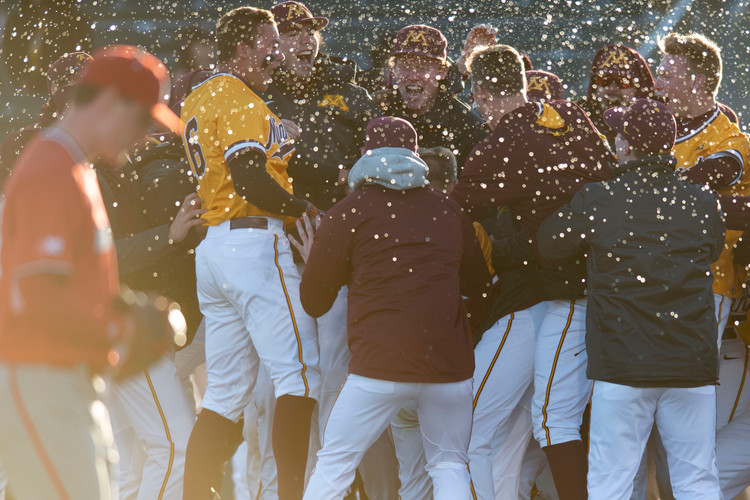 The Gophers welcome Eli Wilson to home plate at Siebert Field on Friday, March 29, 2019. Eli Wilson's home run in the bottom of the tenth inning lead them to a 5-2 win over Nebraska.