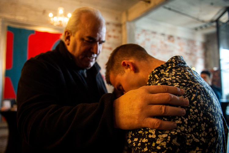 """Diamond receives a blessing after his final service at Riverview Church. In his initial exploration of a military career, Diamond consulted the experience of his late Grandfather, who served in the Army during World War 2. """"Paw Paw"""" as he was known, often placed a hand on Luke's shoulder in times of consequence. """"I still remember the weight of his hands,"""" he said."""