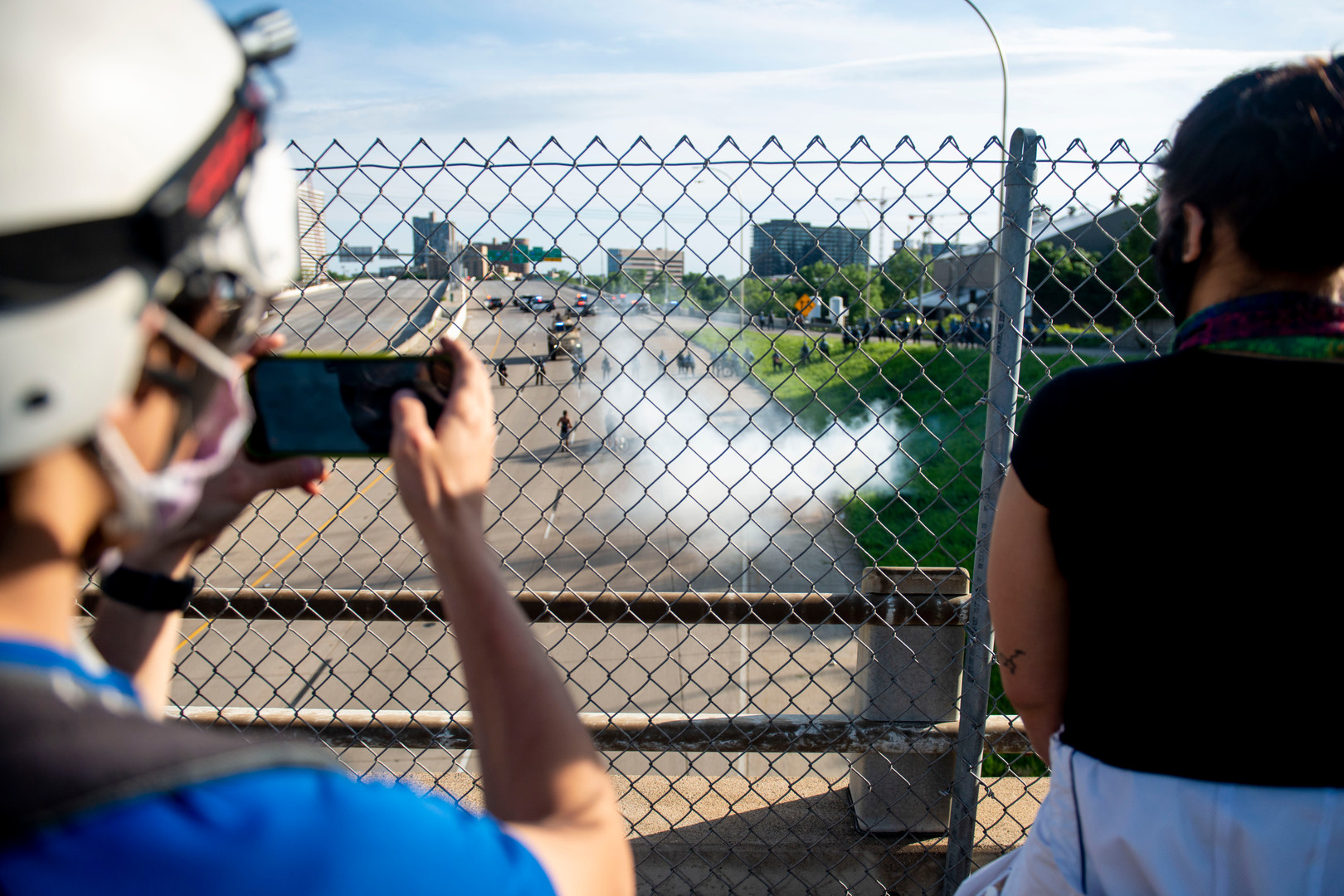 Protesters watch police activity from the bridge above 35W on Sunday, May 31.