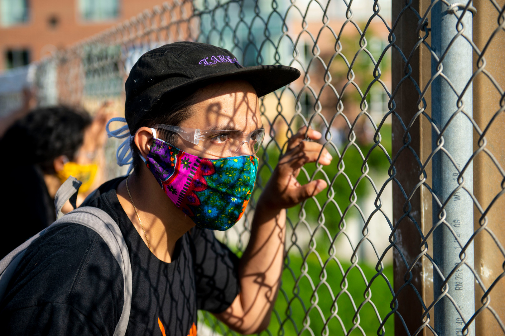A protester looks through the fence on the bridge above 35W on Sunday, May 31.
